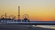 Sunset view of Pleasure Pier amusement park in Galveston, Texas