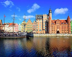 Coastal view of old town and a vintage ship in Gdansk, Poland
