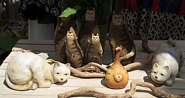 An assortment of souvenir cat statues