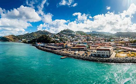 Ocean view of city and the town along the water in St. Georges, Grenada