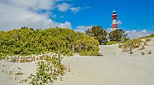 Scenic red and white Moore Lighthouse Point on blue sky in Geraldton, Western Australia