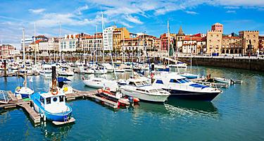 Boats docked at a marina in Gijon, Spain