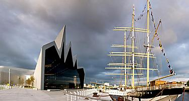 A vintage ship docked next to the Riverside Museum in Glasgow, Scotland