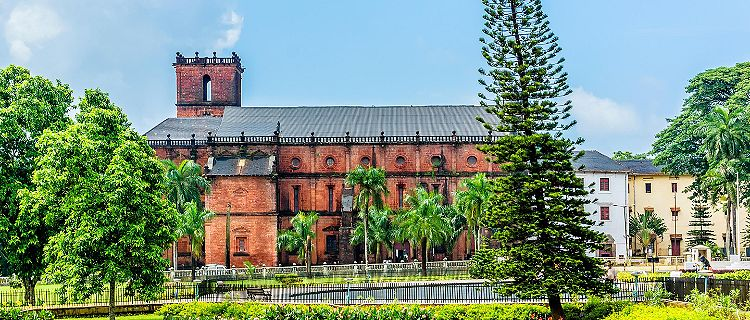 Basilica of Bom jesus in Old Goa inspired by Portuguese architecture with lush landscape in Goa, India