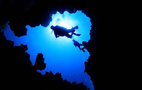 Scuba diving in the underwater caves in Grand Bahama Island, Bahamas