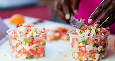 A Bahamian women preparing conch salad