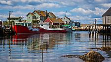 Boats docked at a harbor in Halifax, Nova Scotia