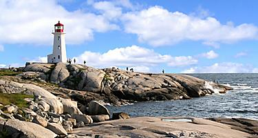 The Mcnabs Island Lighthouse on a rocky coast