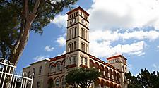 Bermuda's government center building with a clock tower in Hamilton, Bermuda
