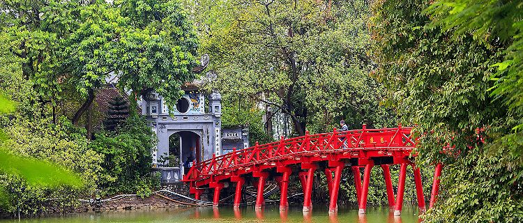 The red Huc Bridge in Hoan Kiem Lake, Hanoi, Vietnam