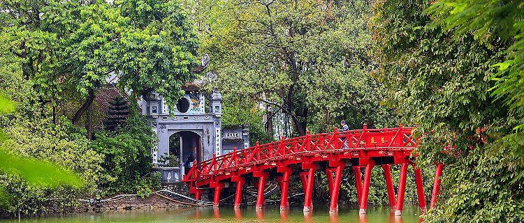The red Huc Bridge in Hoan Kiem Lake, Hanoi, Vietnam