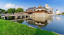 The entrance of the Hiroshima castle with the reflection on the lake