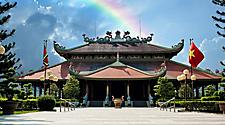 Historical Ben Duoc Temple entrance with a rainbow shining over it in Ho Chi Minh, Vietnam