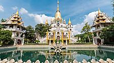 The Buu Long Pagoda at District 9 ornated with gold finishings on a sunny day in Ho Chi Minh, Vietnam