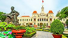 City hall with a garden and statue at the entrance of Ho Chi Minh, Vietnam
