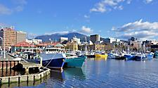 View of the harbour with colorful boats along the dock in Hobart, Tasmania