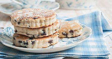 Four welsh griddle cakes on a blue and white plate