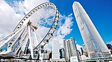 Ferris wheel and skyscrapers during the day in Hong Kong, China