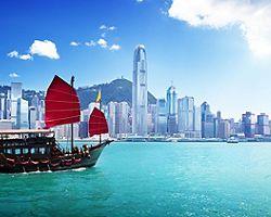 A boat sailing through Hong Kong harbor