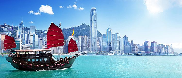A boat sailing through Hong Kong harbor
