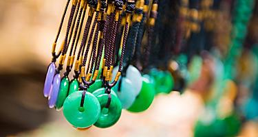 Traditional Jade necklaces sold in markets while souvenir shopping in Hong Kong, China
