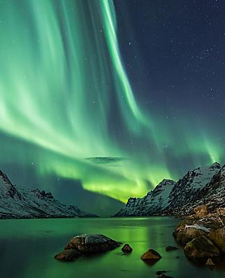 Northern lights over arctic terrain in Norway