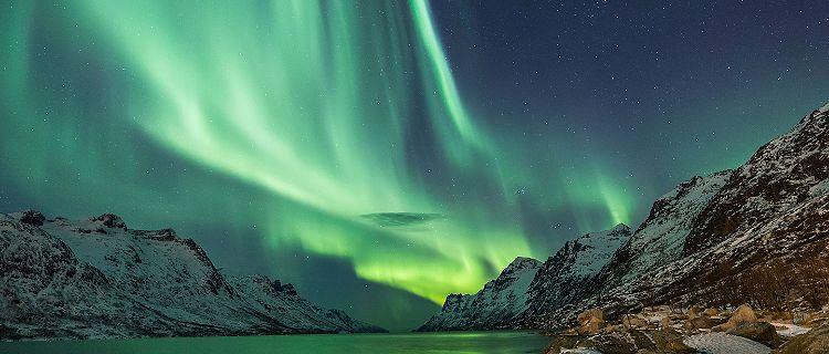 Northern lights over arctic terrain in Norway