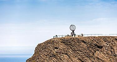 A sphere monument on a cliff in Honningsvag, Norway