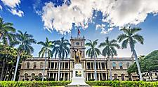 A statue of King Kamehameha in front of the Iolani Palace in Honolulu, Hawaii