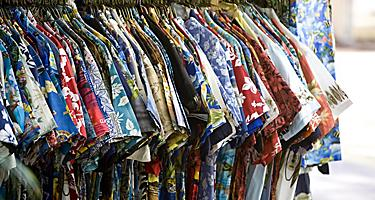 A rack of different Hawaiian shirts