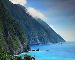Beautiful mountainside cliff with clear blue waters in Hualien, Taiwan