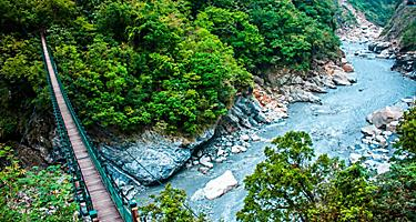 A wooden bridge to help people cross over a stream in Taroko Gorge National Park in Hualien, Taiwan