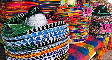Piles of traditional colorful Mexican hats sold in souvenir shops