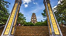 Tall yellow columns at the entrance of the Thien Mu Pagoda in Vietnam