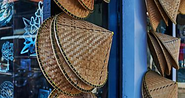 Traditional bamboo hats are common souvenirs while shopping in Vietnam