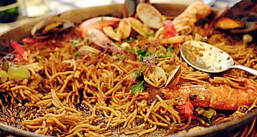 A platter of seafood noodle paella in Ibiza, Spain
