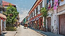 City center street scene in historic colonial town with horse and carriage in Ilocos, Philippines