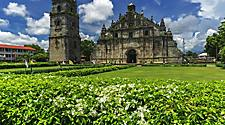 Famous landmark Paoay church with a decayed look and surrounded by beautifully kept greenery, in Ilocos, Philippines