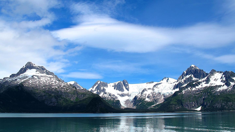 https://rccl-h.assetsadobe.com/is/image/content/dam/royal/data/ports/inside/alaska-inside-passage-views-from-ocean-mountains-snow.jpg?$1440x810$