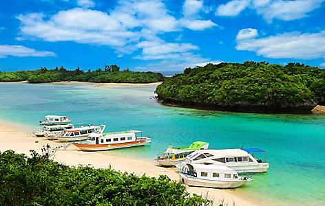 Boats along Kabira bay in Ishigaki, Japan