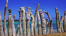 Native sculptures lining the coast of Isle of Pines, New Caledonia