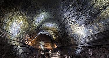 A dark underground cave in the empty Manjanggul Lava Tube Cave on Jeju Island, South Korea