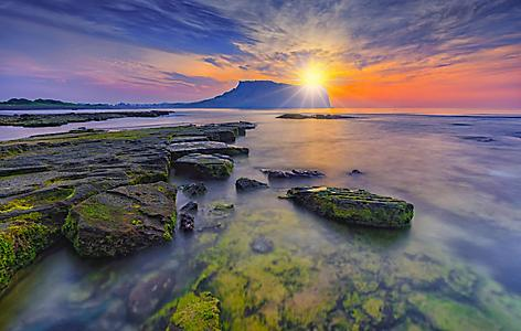 View of the Seongsan, Ilchulbong underwater volcano during sunrise in Jeju Island, South Korea