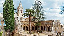The Church of Pater Noster with beautiful classical architecture and green pine trees in Jerusalem, Israel
