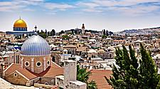 A panoramic view of Jerusalem, Israel seeing the entire city with religious domes and stoned small buildings