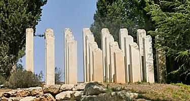 The Holocaust Sculpture with broken columns coming out of the ground in Jerusalem, Israel
