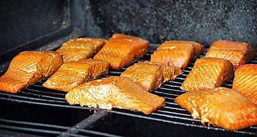 Salmon being cooked on the grill in Alaska