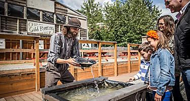Family fun activity of gold panning in Juneau, Alaska