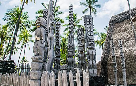 Ancient polynesian tiki wooden craving statues in Kailua Kona, Hawaii