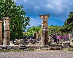 Multiple ruins of ancient Greek pillars in Olympia